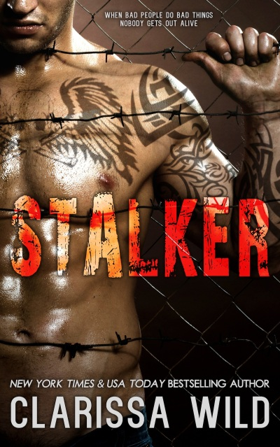 the very muscular handsome felon guy ,  out of netting   steel fence